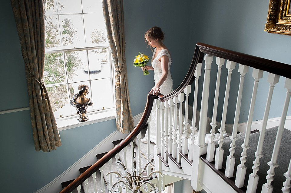 Bride walking down the stairs, heart weddings photography