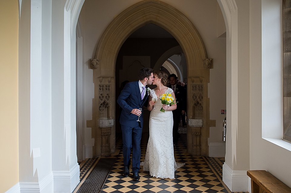 Bride and groom leaving the great hall. Heart Wedding Photography