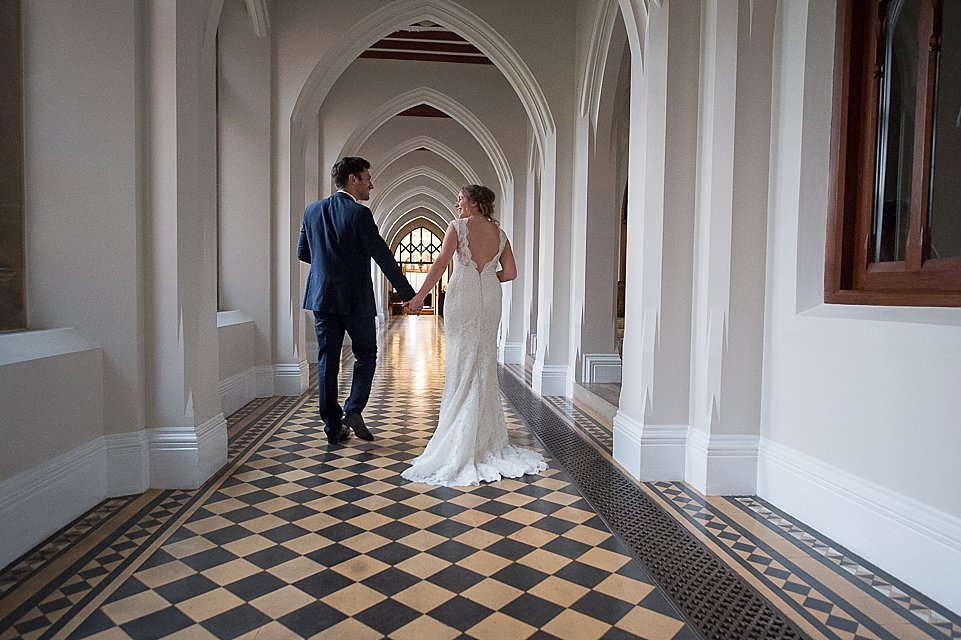 Bride and Groom walking at Stanbrook Abbey, heart weddings